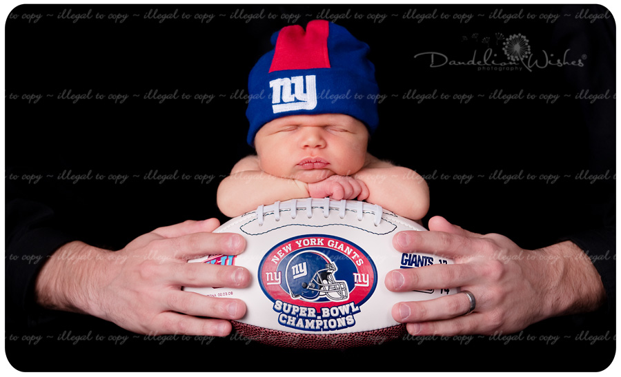New York Giants fans from Bristow - Gainesville, Virginia.  Newborn baby on football.